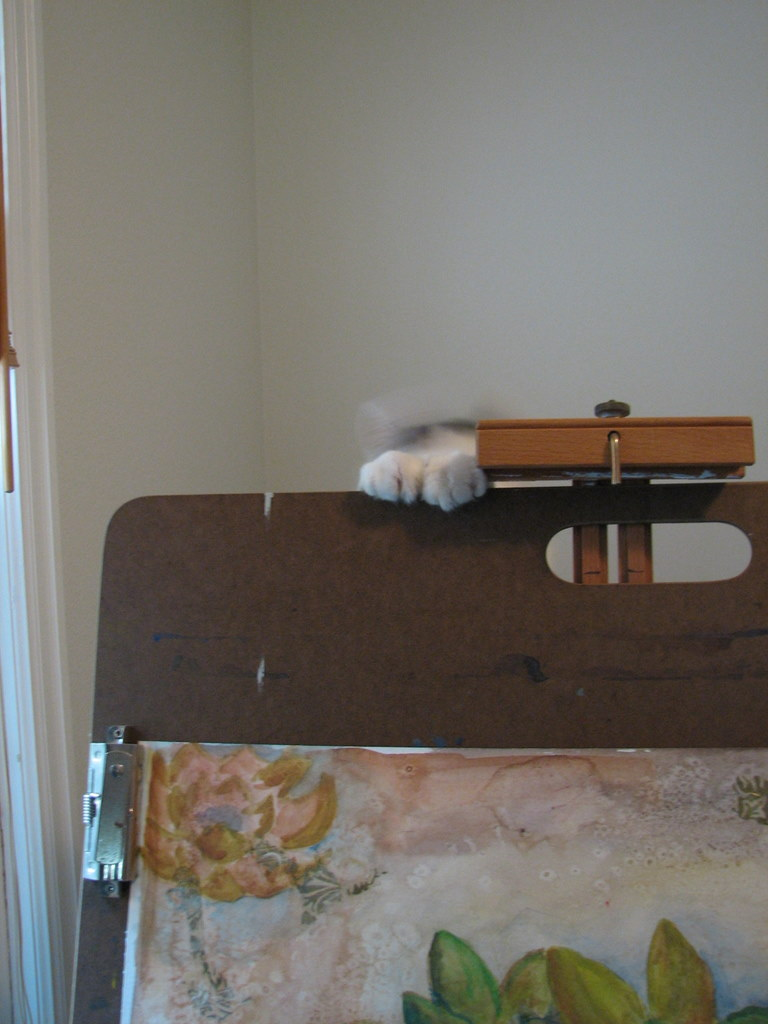 paws over easel